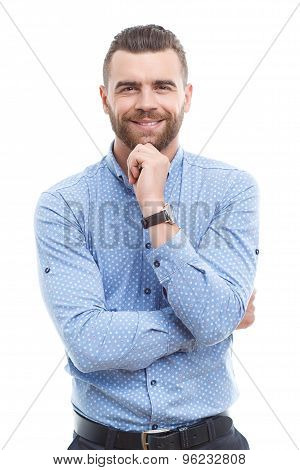 Handsome businessman touching chin isolated