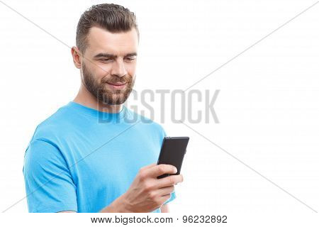 Handsome man with beard holding mobile phone