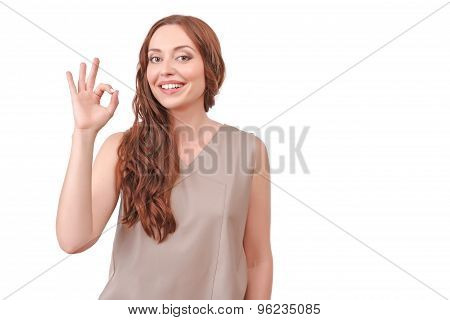 Pretty red-haired woman pointing ok