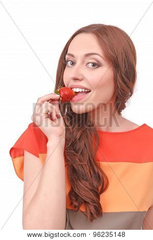 Pleasant red-haired woman eating strawberry