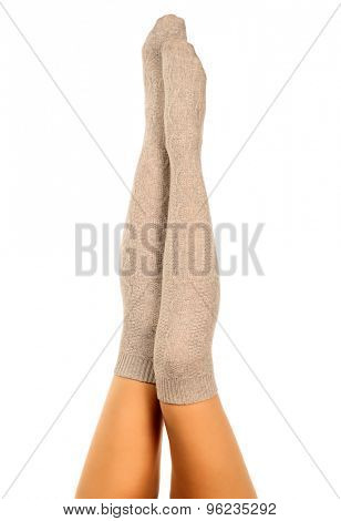 Long female legs in knitted socks, white background, isolated