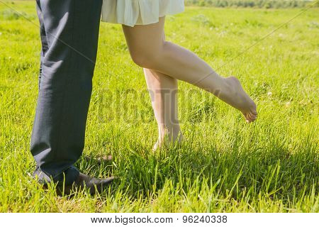 Legs Of Inloved Couple.