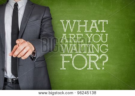 What are you waiting on on blackboard with businessman