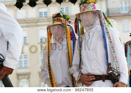 ZAGREB, CROATIA - JULY 18: Members of folk group from Putnikovici, Croatia during the 49th International Folklore Festival in center of Zagreb, Croatia on July 18, 2015