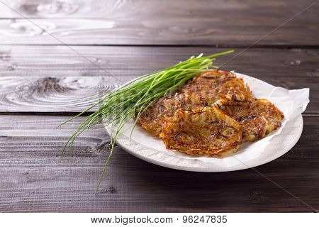 Potato fritters with red onion and spices