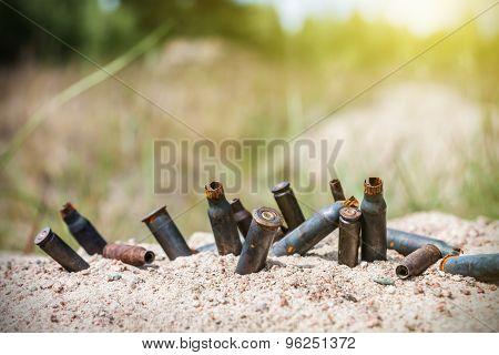 Rusty Bullet Shells On The Battlefield