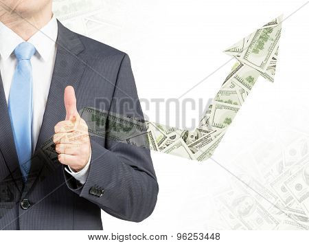 Close Up Of Businessman With The Thumb Up. Increasing Dollar Arrow.