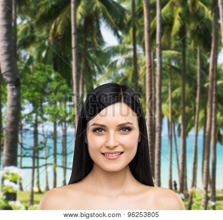 A Portrait Of A Smiling Attractive Lady. Tropical Island Landscape As A Background.