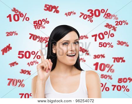 Astonished Brunette Surrounded By Discount And Sale Numbers: 10% 20% 30% 50% 70%. Blue Background.