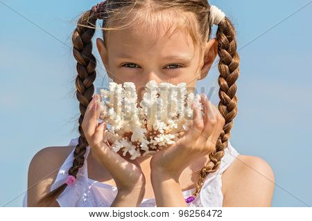 Portrait Of A Girl With White Corals In Hands