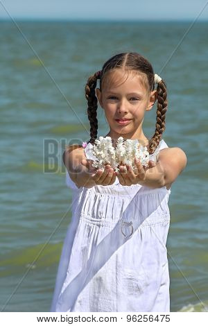 Girl Holding Corals In His Outstretched Hands