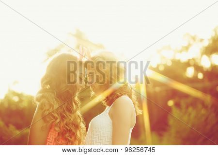 Best Girlfriends Are Looking Into Each Others Eyes. Sunset.