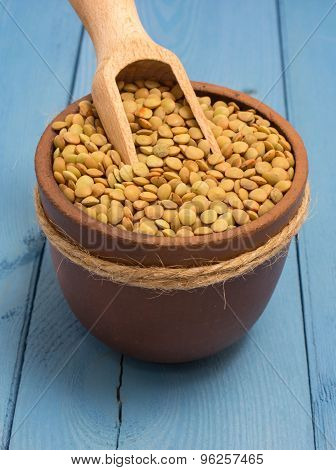 The Seeds Of Green Lentils On A Blue Board