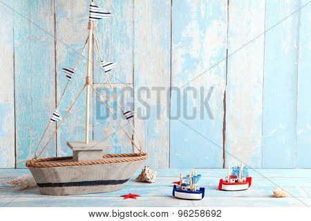 blue wooden background with boats