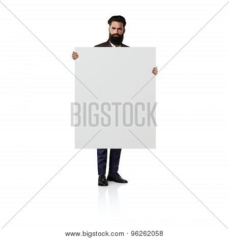 Bearded man with blank white canvas. Isolated