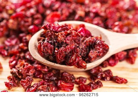 Dry Red Barberry Spices In The Wooden Spoons