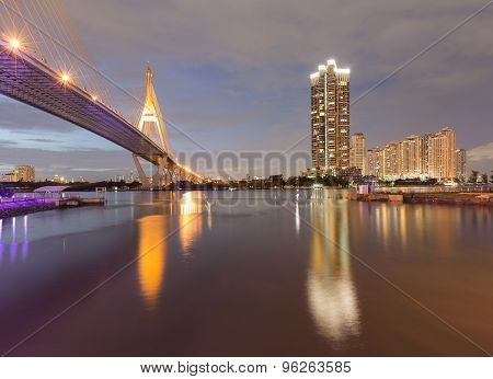 Twilight of Suspension bridge and apartment with water front view