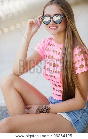 Young smiling woman outdoors portrait