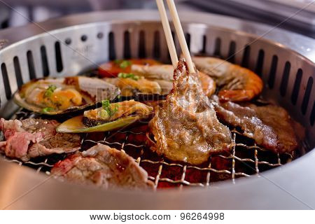 Mixed Roasted Meat And Seafood And Chopsticks On The Bbq Grill On Roast.