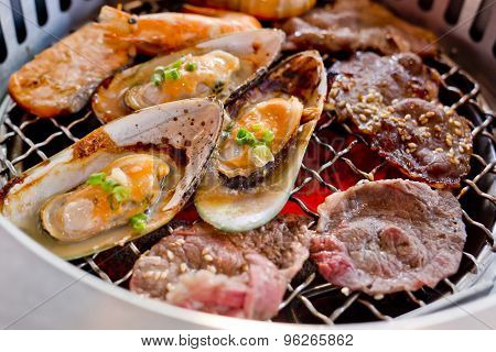 Mixed Roasted Meat And Seafood On The Bbq Grill On Roast.