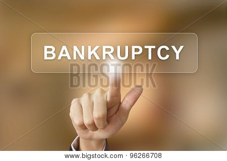 Business Hand Clicking Bankruptcy Button On Blurred Background