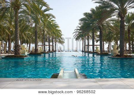 MUSCAT, OMAN - 2015.04.10: Swimming pool of the Al Bustan hotel in Muscat. 2015.04.10  in Muttrah, Sultanate of Oman, Middle East