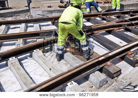 Some Workers Repair And Replace Some Rail Trams
