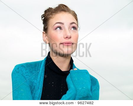 Pretty young woman smiling happily