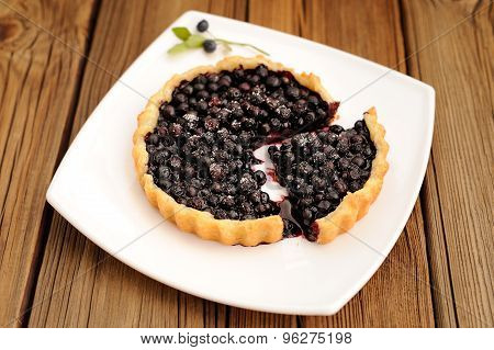 Homemade Tart With Whole Wild Blueberries Cut In Square White Plate With Fork And Wild Blueberry Twi