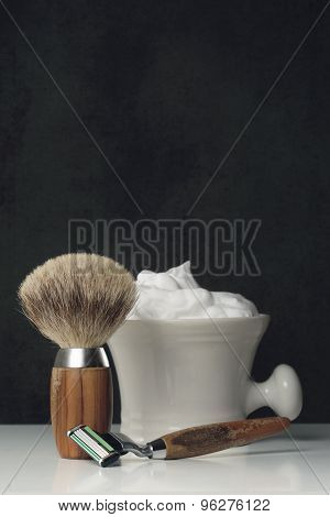 Vintage Shaving Equipment On White Table And Dark Background