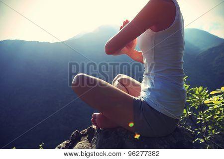 young yoga woman sit meditation on sunrise mountain peak