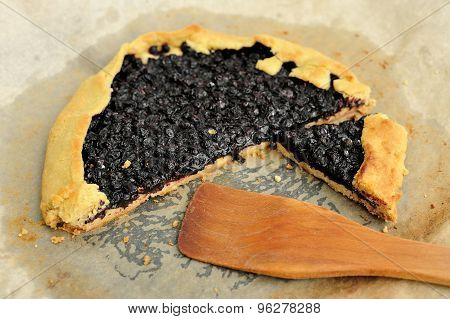 Delicious Vegan Galette With Wild Blueberry Cut With Wooden Spatula On Baking Paper