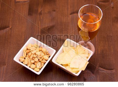 Aperitif and pretzels on wood from above
