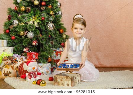 Five-year Girl With Small Gifts In Lid Of The Box