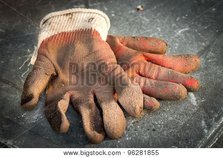 Dirty Work Gloves Laying On The Table