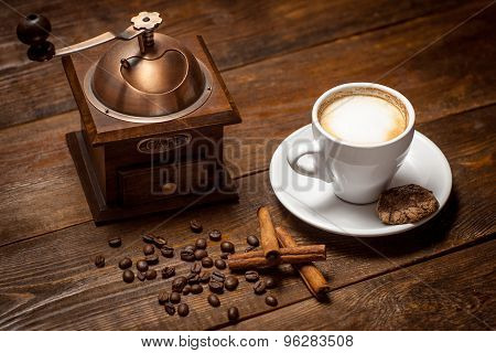 Cappuccino With Cinnamon And Antique Coffee Mill