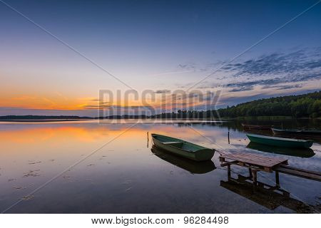 Beautiful Lake Sunset With Fisherman Boat