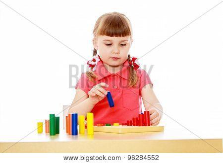 Beautiful little girl in a Montessori class
