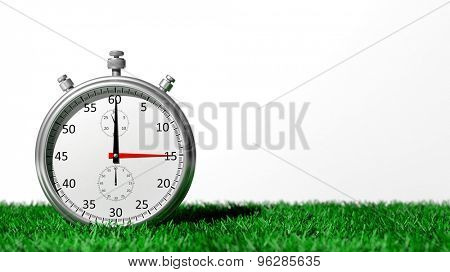 Silver chronometer on green grass, isolated on white