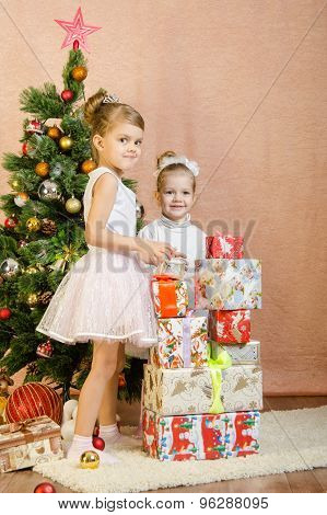 Two Girls Built A Tower Of Gifts