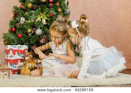 Two Girls Opening Christmas Gift