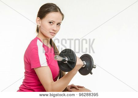 Athlete Swings Dumbbells Muscles Of The Right Hand