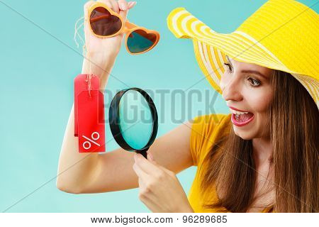 Woman Choosing Glasses Searching Through Magnifying Glass
