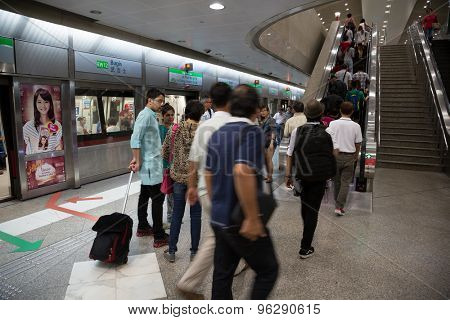 SINGAPORE - CIRCA FEBRUARY, 2015: People Bugis MRT station in Singapore. MRT is a rapid transit system forming the major component of the railway system in Singapore.