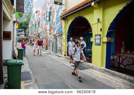 SINGAPORE - CIRCA FEBRUARY, 2015: Tourists in the streets of the Arab quarter (Kampong Glam). Arab Quarter is the oldest historic shopping district of Singapore, is popular for visiting tourists.