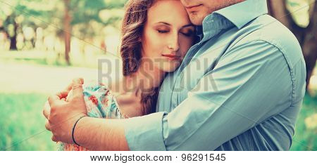 Man Embracing Woman In Summer Park