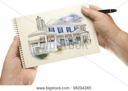 Male Hands Holding Pen and Pad of Paper with House Drawing Isolated on a White Background.