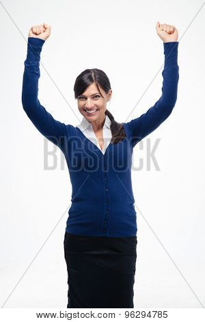Success businesswoman celebrating her winner with arms raised up isolated on a white background. Looking at camera