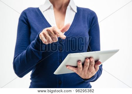 Closeup portrait of female hands using tablet computer isolated on a white bacground