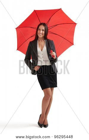full-length portrait of smiley woman under red umbrella. isolated on white background